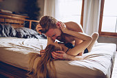 Couple cuddling in the bedroom