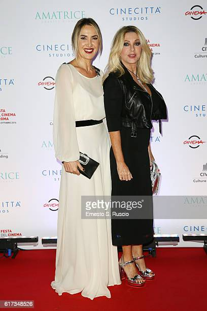 Desiree Colapietro and Paola Ferrari walk a red carpet at the charity dinner for Amatrice during the 11th Rome Film Festival at Auditorium Parco...