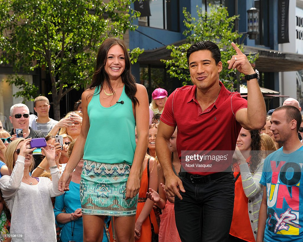 Desiree Hartsock (L) and Mario Lopez rap on set of 'Extra' at The Grove on June 6, 2013 in Los Angeles, California.
