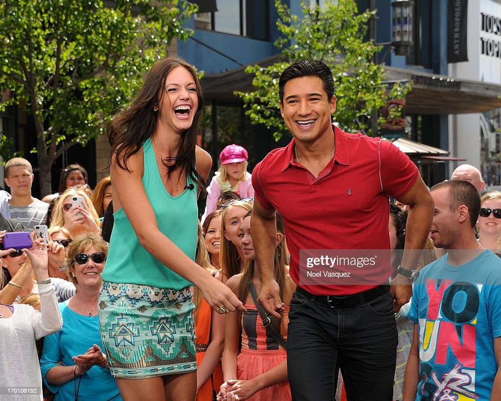 Desiree Hartsock (L) and <a gi-track='captionPersonalityLinkClicked' href=/galleries/search?phrase=Mario+Lopez&family=editorial&specificpeople=235992 ng-click='$event.stopPropagation()'>Mario Lopez</a> rap on set of 'Extra' at The Grove on June 6, 2013 in Los Angeles, California.