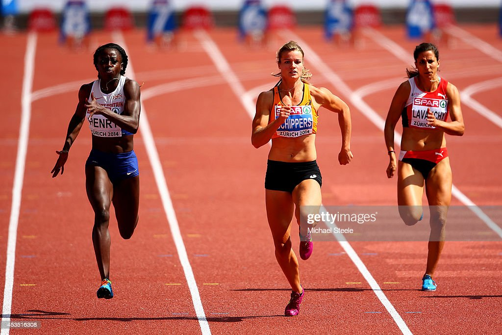 Desiree Henry of Great Britain and Northern Ireland, Dafne Schippers of the Netherlands and Marisa Lavanchy of Switzerland compete in the Women's 100 metres heats during day one of the 22nd European Athletics Championships at Stadium Letzigrund on August 12, 2014 in Zurich, Switzerland.