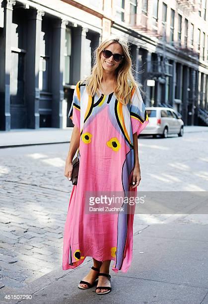 Desiree is seen around Soho wearing an Andanuroj dress vintage bag and HM sunglasses on June 30 2014 in New York City