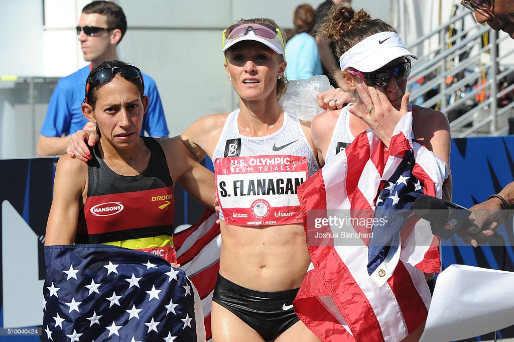 Desiree Linden, Shalene Flanagan and Amy Cragg celebrate after qualifing for the Women's Olympic Team in the U.S. Olympic Team Trials Marathon on February 13, 2016 in Los Angeles, California.
