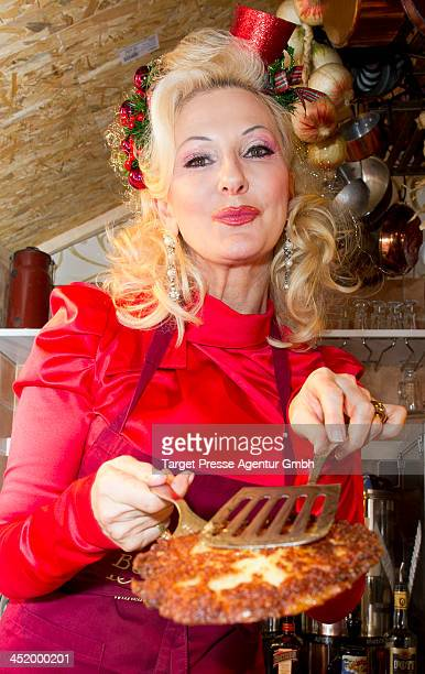 Desiree Nick attends the 'KartoffelpufferBratCharity' at the Berlin Christmas Market on November 25 2013 in Berlin Germany