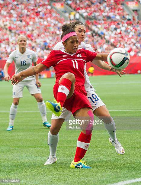 Desiree Scott of Canada clears the ball while pressured by Jodie Taylor of England during the FIFA Women's World Cup Canada 2015 Quarter Final match...