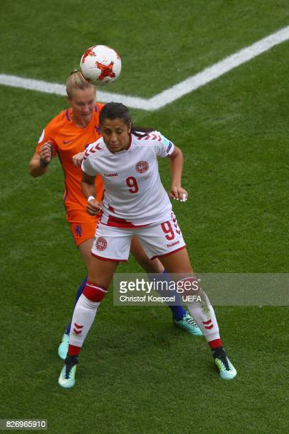 Desiree van Lunteren of the Netherlands and Nadia Nadim of Denmark go up for a header during the UEFA Women's Euro 2017 Final between Denmark and...