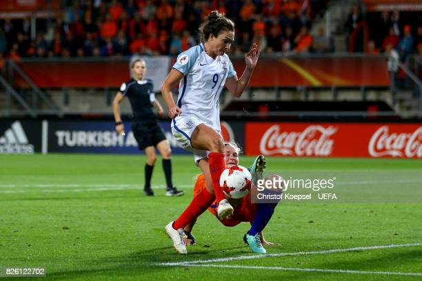 Desiree van Lunteren of the Netherlands challenges Jodie Taylor of England during the UEFA Women's Euro 2017 Second Semi Final match between...