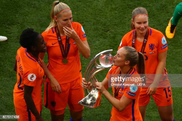 Desiree van Lunteren of the Netherlands kisses the winning lifts the trophy on the podium after winning after the Netherlands v Denmark UEFA Women's...