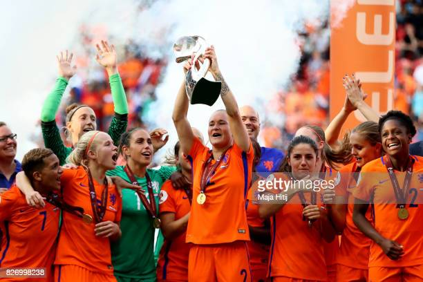 Desiree van Lunteren of the Netherlands lifts the trophy following the Final of the UEFA Women's Euro 2017 between Netherlands v Denmark at FC Twente...