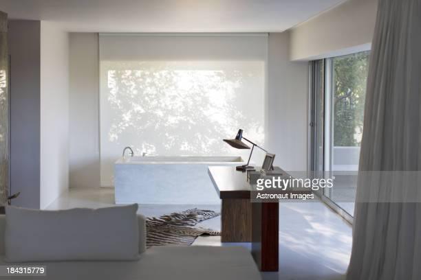 Desk and bathtub in modern house