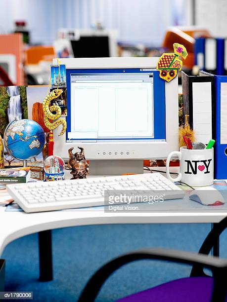 Desk Covered in International Souvenirs and Knick Knacks