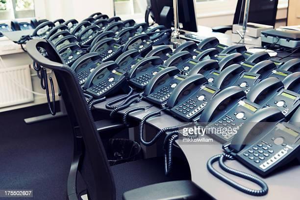 Desk full of phones