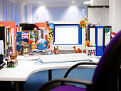 Desk in an Open Plan Office Covered in International Souvenirs