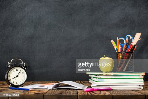 Desk Of Student, Alarm Clock, Books and Pencils : Foto de stock
