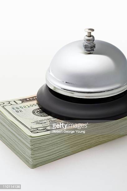 Desk or Service Bell on Stack of U.S. Currency