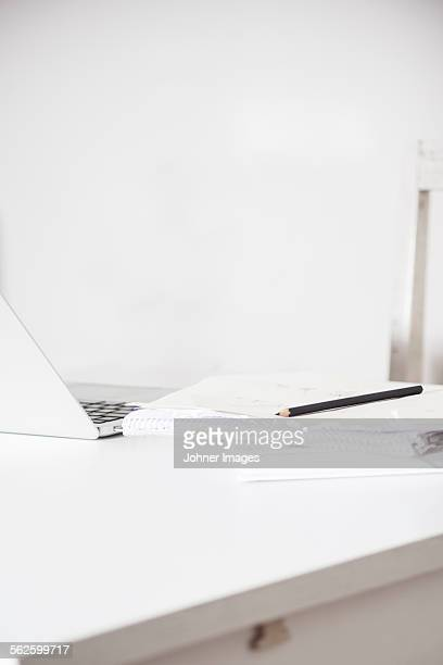 Desk with notebook and laptop