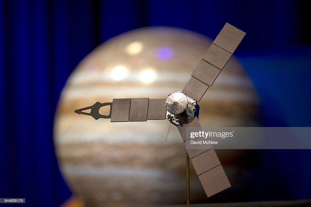 A desktop model of the Juno spacecraft is seen as NASA officials and the public look forward to the Independence Day arrival of the the Juno spacecraft to Jupiter, at JPL on June 30, 2016 in Pasadena, California. After having traveling nearly 1.8 billion miles over the past five years, the NASA Juno spacecraft will arrival to Jupiter on the Fourth of July to go enter orbit and gather data to study the enigmas beneath the cloud tops of Jupiter. The risky $1.1 billion mission will fail if it does not enter orbit on the first try and overshoots the planet.