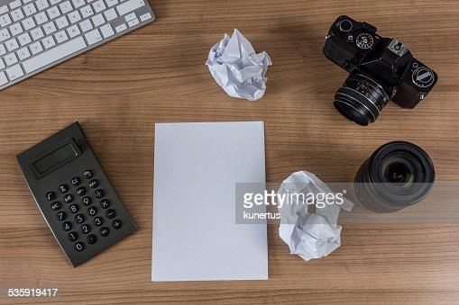 desktop with camera keyboard and calculator : Stock Photo