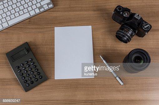 desktop with camera keyboard and calculator : Stock Photo