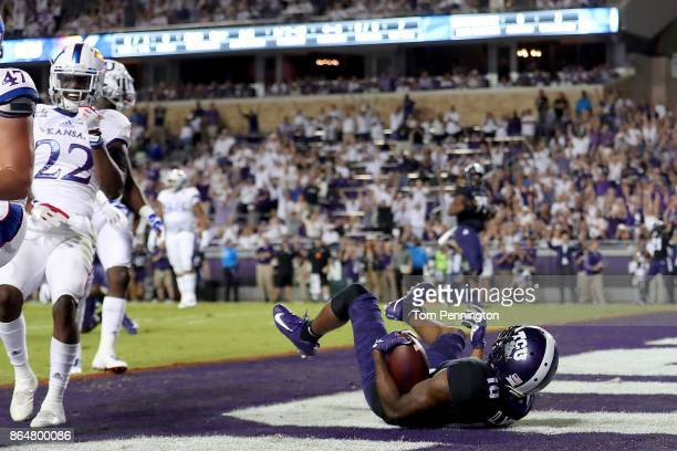 Desmon White of the TCU Horned Frogs scores a touchdown against the Kansas Jayhawks in the first quarter at Amon G Carter Stadium on October 21 2017...