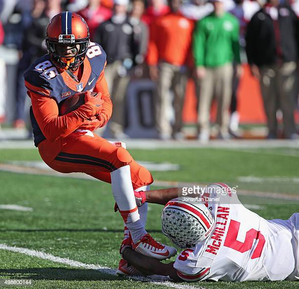 Desmond Cain of the Illinois Fighting Illini is shoe tackled by Raekwon McMillan of the Ohio State Buckeyes at Memorial Stadium on November 14 2015...
