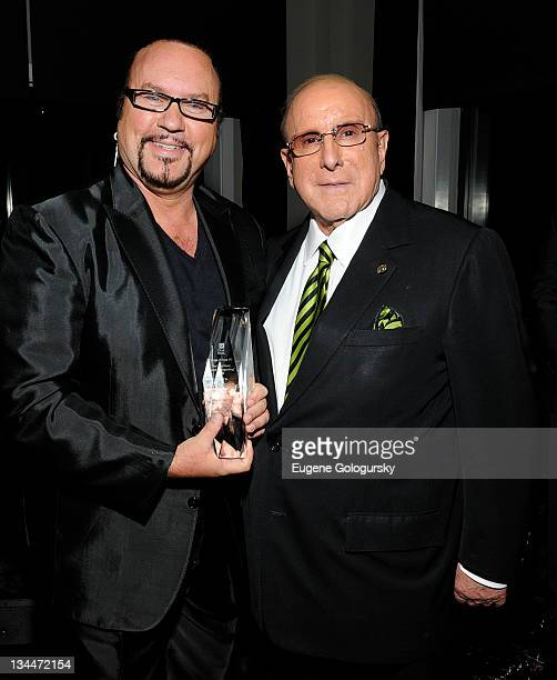 Desmond Child and Clive Davis attend the Esquire Apartment benefit event hosted by City of Hope at 16 Main Street DUMBO on December 1 2011 in New...