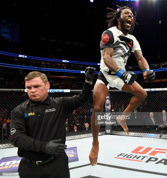 Desmond Green celebrates his split decision victory over Josh Emmett in their lightweight bout during the UFC 210 event at KeyBank Center on April 8...