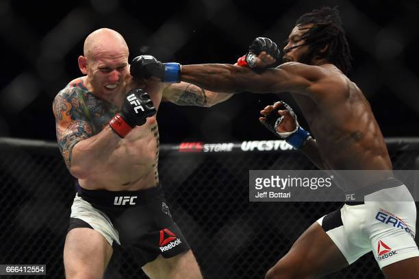 Desmond Green punches Josh Emmett in their lightweight bout during the UFC 210 event at the KeyBank Center on April 8 2017 in Buffalo New York