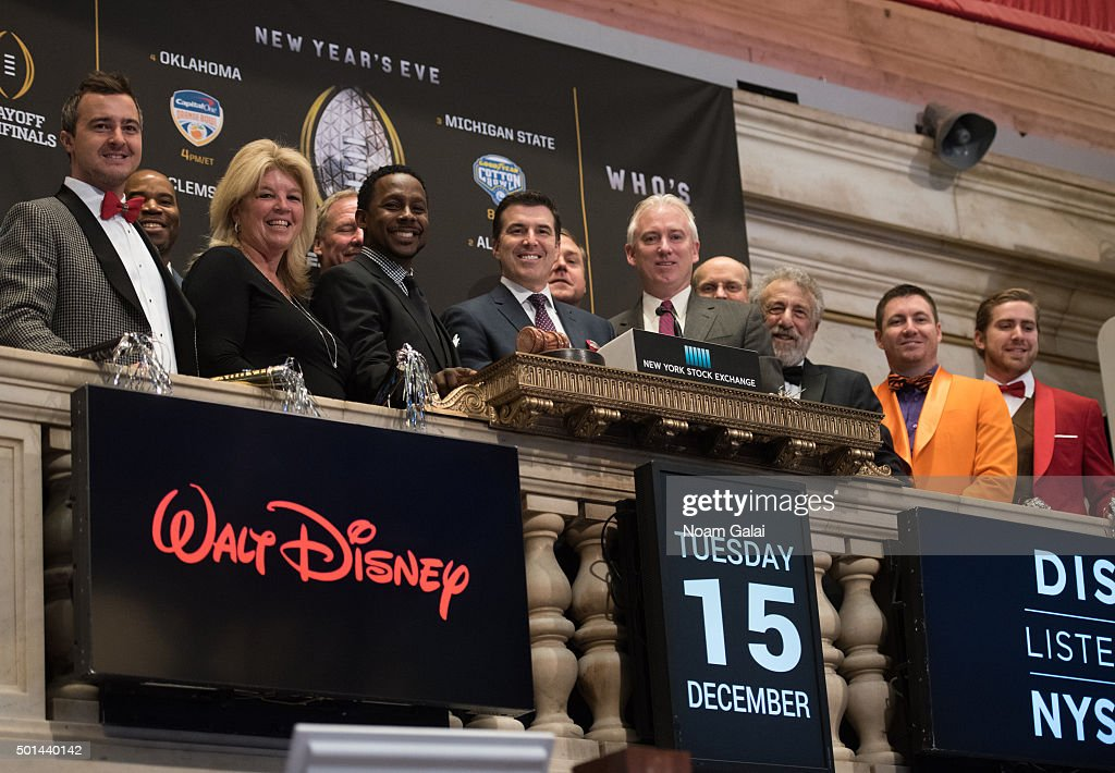 Desmond Howard Rece Davis Jim Byrne and George Zimmer ring the NYSE opening bell at New York Stock Exchange on December 15 2015 in New York City