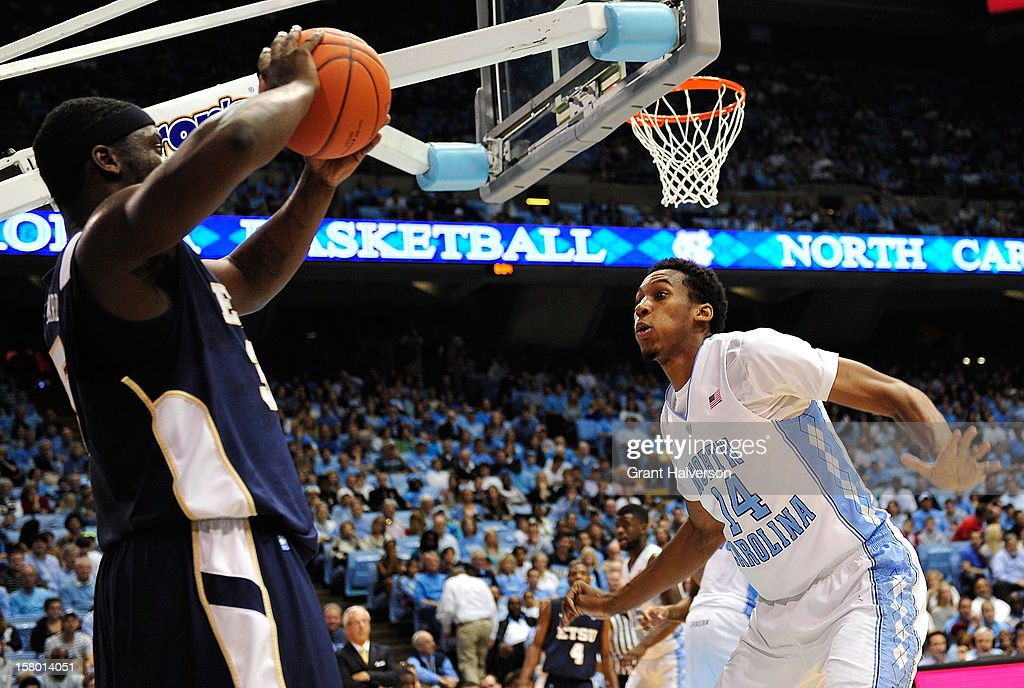 Desmond Huber #14 of the North Carolina Tar Heels defends an inbounds pass by Kinard Gadsden-Gilliard #35 of the East Tennessee State Buccaneers during play at Dean Smith Center on December 8, 2012 in Chapel Hill, North Carolina.