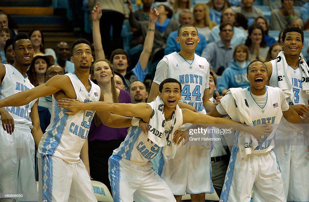 Desmond Hubert #14, J.P. Tokoto #13, <a gi-track='captionPersonalityLinkClicked' href=/galleries/search?phrase=Marcus+Paige&family=editorial&specificpeople=7880805 ng-click='$event.stopPropagation()'>Marcus Paige</a> #5, <a gi-track='captionPersonalityLinkClicked' href=/galleries/search?phrase=Justin+Jackson+-+Basketball+Player+-+Forward+-+Born+1995&family=editorial&specificpeople=12699010 ng-click='$event.stopPropagation()'>Justin Jackson</a> #44, Nate Britt #0 and <a gi-track='captionPersonalityLinkClicked' href=/galleries/search?phrase=Kennedy+Meeks&family=editorial&specificpeople=9510873 ng-click='$event.stopPropagation()'>Kennedy Meeks</a> #3 of the North Carolina Tar Heels cheer on the reserves during the final minute of a win over the UAB Blazers during their game at the Dean Smith Center on December 27, 2014 in Chapel Hill, North Carolina. North Carolina won 89-58.