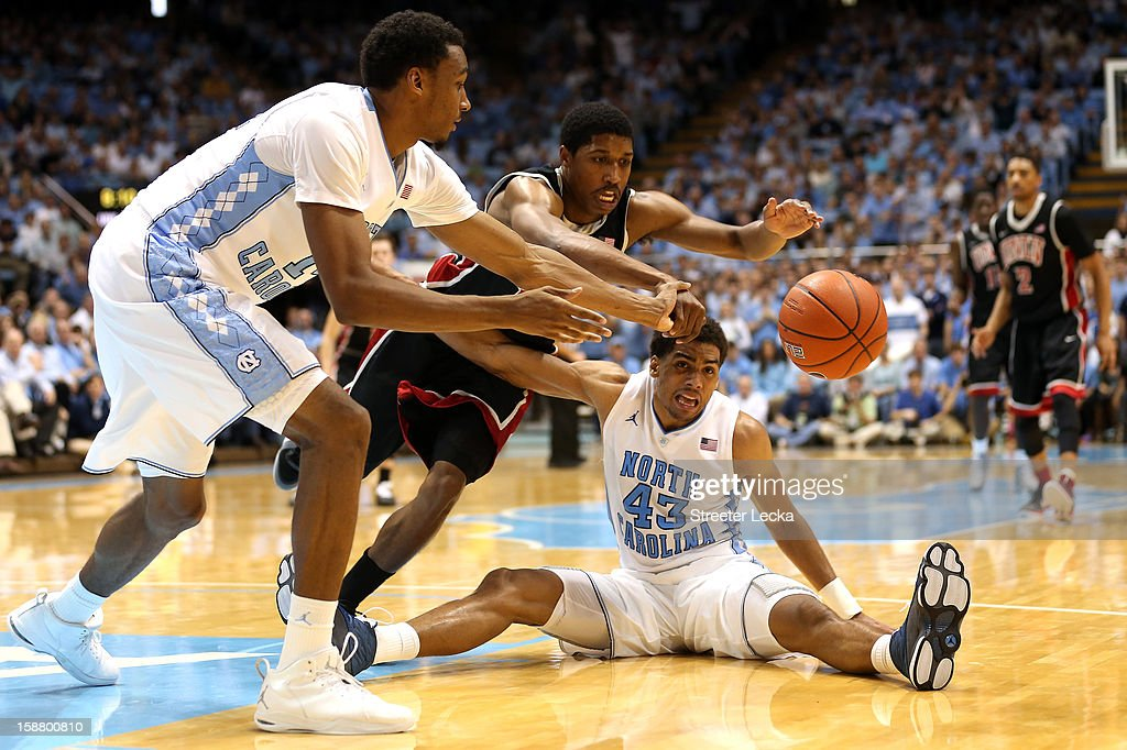 Desmond Hubert #14 of the North Carolina Tar Heels and teammate James Michael McAdoo #43 go after a loose ball with Justin Hawkins #31 of the UNLV Rebels during their game at Dean Smith Center on December 29, 2012 in Chapel Hill, North Carolina.