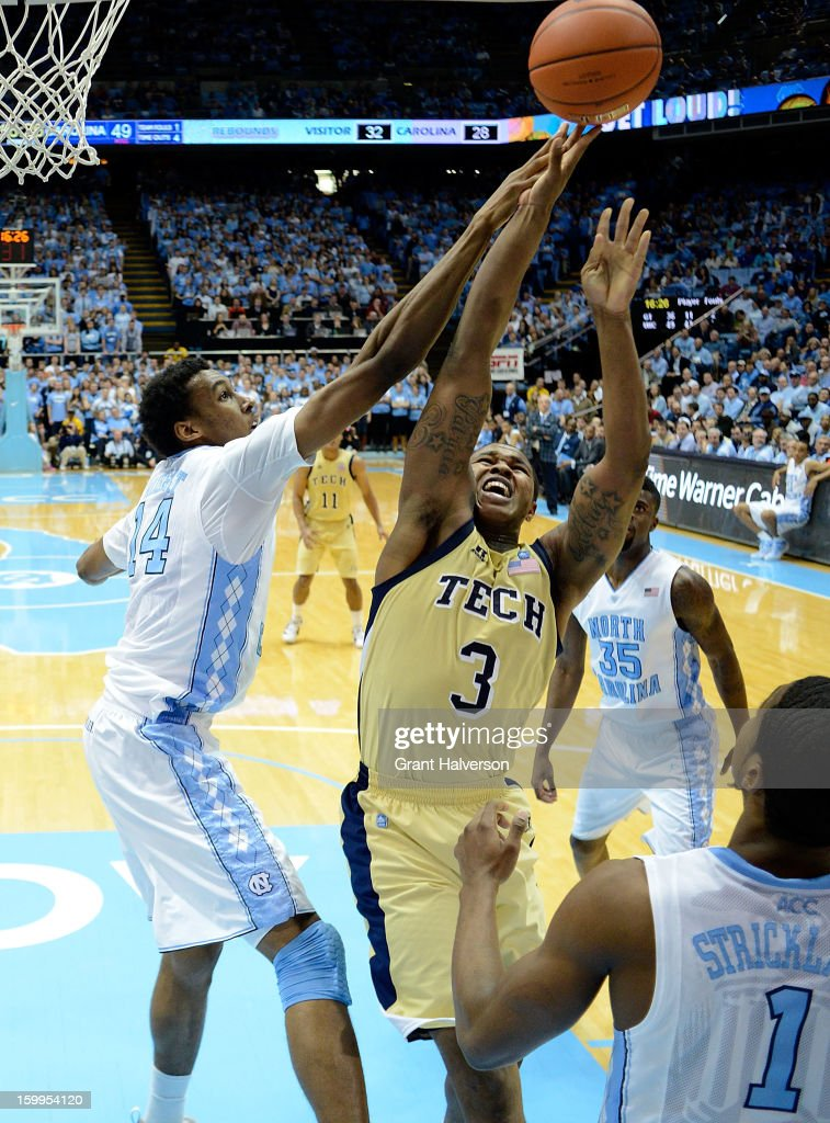 Desmond Hubert #14 of the North Carolina Tar Heels blocks a shot by Marcus Georges-Hunt #3 of the Georgia Tech Yellow Jackets during play at the Dean Smith Center on January 23, 2013 in Chapel Hill, North Carolina. North Carolina won 79-63.