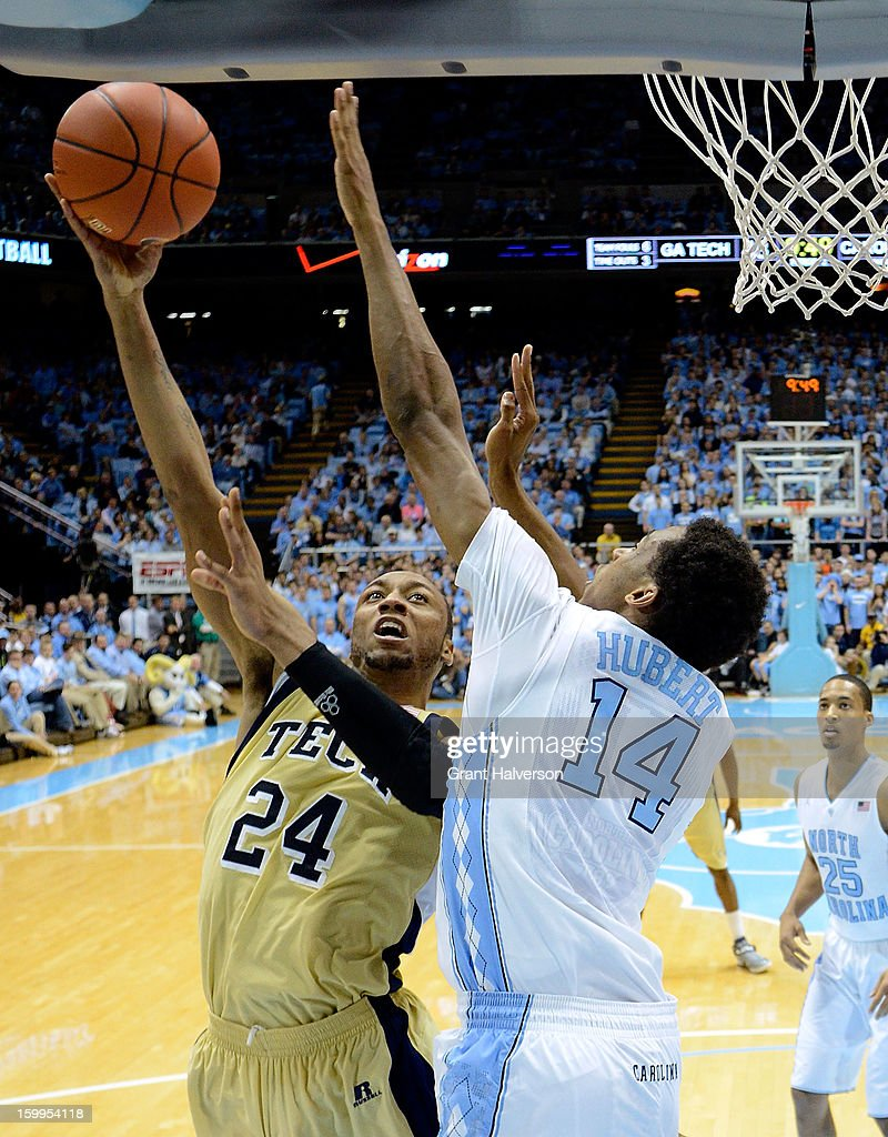 Desmond Hubert #14 of the North Carolina Tar Heels defends a shot by Kammeon Holsey #24 of the Georgia Tech Yellow Jackets during play at the Dean Smith Center on January 23, 2013 in Chapel Hill, North Carolina. North Carolina won 79-63.