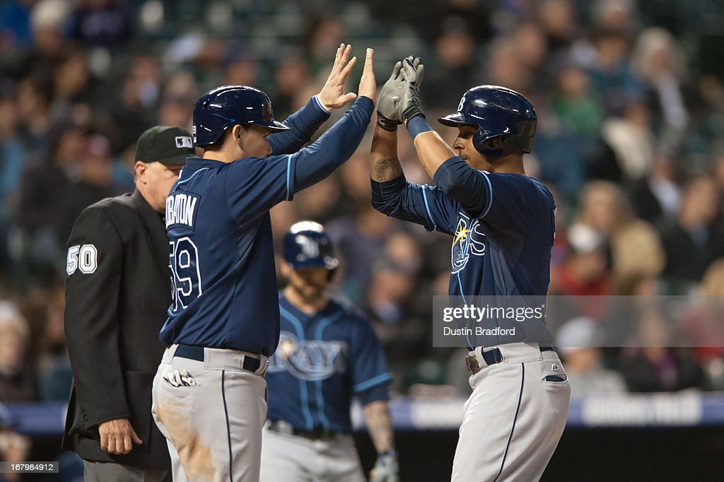 <a gi-track='captionPersonalityLinkClicked' href=/galleries/search?phrase=Desmond+Jennings&family=editorial&specificpeople=5974085 ng-click='$event.stopPropagation()'>Desmond Jennings</a> #8 and Jose Lobaton #59 of the Tampa Bay Rays celebrate a fifth-inning two-run Jennings home run during a game against the Colorado Rockies at Coors Field on May 3, 2013 in Denver, Colorado. The Rays led the Rockies 4-3 after four and a half innings.