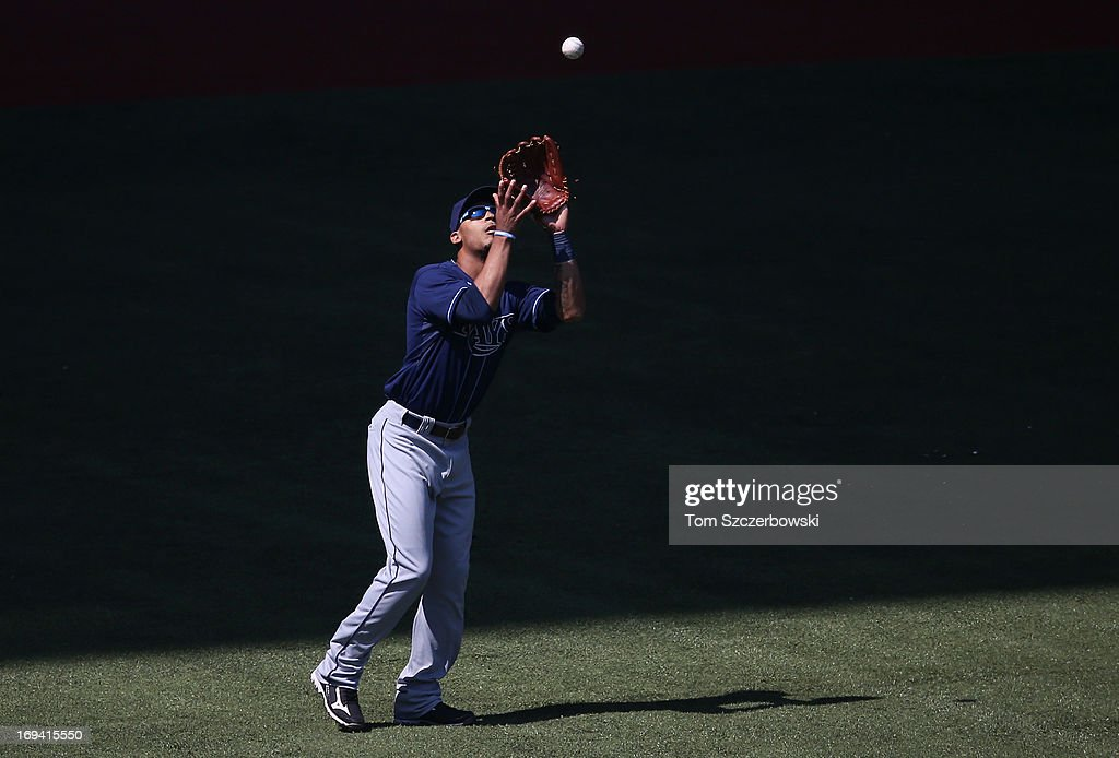 <a gi-track='captionPersonalityLinkClicked' href=/galleries/search?phrase=Desmond+Jennings&family=editorial&specificpeople=5974085 ng-click='$event.stopPropagation()'>Desmond Jennings</a> #8 of the Tampa Bay Rays catches a fly ball in the seventh inning during MLB game action against the Toronto Blue Jays on May 20, 2013 at Rogers Centre in Toronto, Ontario, Canada.