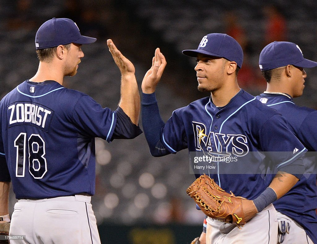 <a gi-track='captionPersonalityLinkClicked' href=/galleries/search?phrase=Desmond+Jennings&family=editorial&specificpeople=5974085 ng-click='$event.stopPropagation()'>Desmond Jennings</a> #8 of the Tampa Bay Rays celebrates a 7-1 win over the Los Angeles Angels with <a gi-track='captionPersonalityLinkClicked' href=/galleries/search?phrase=Ben+Zobrist&family=editorial&specificpeople=2120037 ng-click='$event.stopPropagation()'>Ben Zobrist</a> #18 at Angel Stadium of Anaheim on September 3, 2013 in Anaheim, California.