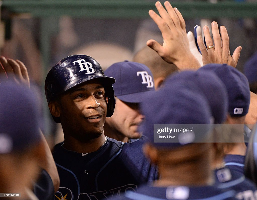 <a gi-track='captionPersonalityLinkClicked' href=/galleries/search?phrase=Desmond+Jennings&family=editorial&specificpeople=5974085 ng-click='$event.stopPropagation()'>Desmond Jennings</a> #8 of the Tampa Bay Rays celebrates his solo homerun with the dugout for a 2-1 lead over the Los Angeles Angels during the third inning at Angel Stadium of Anaheim on September 3, 2013 in Anaheim, California.
