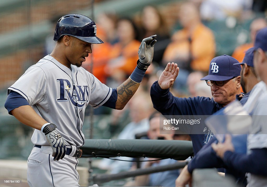<a gi-track='captionPersonalityLinkClicked' href=/galleries/search?phrase=Desmond+Jennings&family=editorial&specificpeople=5974085 ng-click='$event.stopPropagation()'>Desmond Jennings</a> #8 of the Tampa Bay Rays celebrates hitting a solo home run during the first inning against the Baltimore Orioles at Oriole Park at Camden Yards on April 16, 2013 in Baltimore, Maryland.