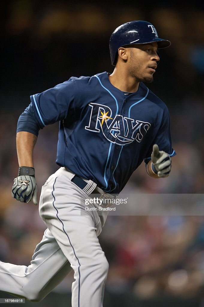 <a gi-track='captionPersonalityLinkClicked' href=/galleries/search?phrase=Desmond+Jennings&family=editorial&specificpeople=5974085 ng-click='$event.stopPropagation()'>Desmond Jennings</a> #8 of the Tampa Bay Rays circles the bases after hitting a two-run home run in the fifth inning of a game against the Colorado Rockies at Coors Field on May 3, 2013 in Denver, Colorado. The Rays led the Rockies 4-3 after four and a half innings.