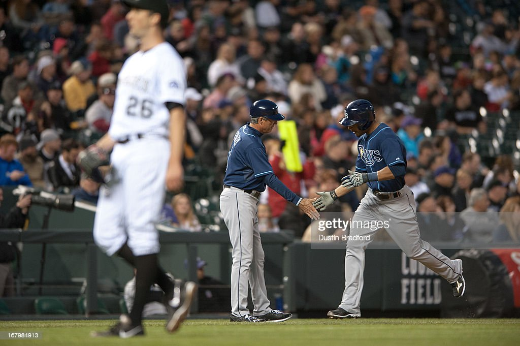 <a gi-track='captionPersonalityLinkClicked' href=/galleries/search?phrase=Desmond+Jennings&family=editorial&specificpeople=5974085 ng-click='$event.stopPropagation()'>Desmond Jennings</a> #8 of the Tampa Bay Rays circles the bases and celebrates with third base coach Tom Foley #6 after hitting a two-run home run in the fifth inning of a game against Jeff Francis #26 of the Colorado Rockies at Coors Field on May 3, 2013 in Denver, Colorado. The Rays led the Rockies 4-3 after four and a half innings.