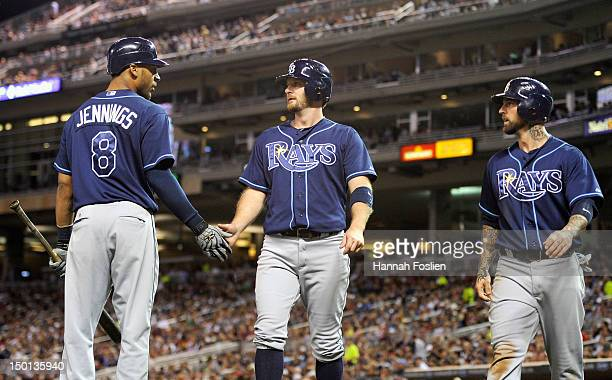 Desmond Jennings of the Tampa Bay Rays congratulates Jeff Keppinger and Ryan Roberts on scoring against the Minnesota Twins during the sixth inning...