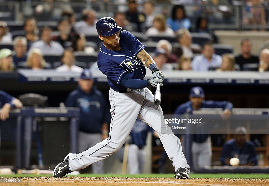 Desmond Jennings #8 of the Tampa Bay Rays connects on a fifth inning RBI single against the New York Yankees at Yankee Stadium on September 14, 2012 in the Bronx borough of New York City.