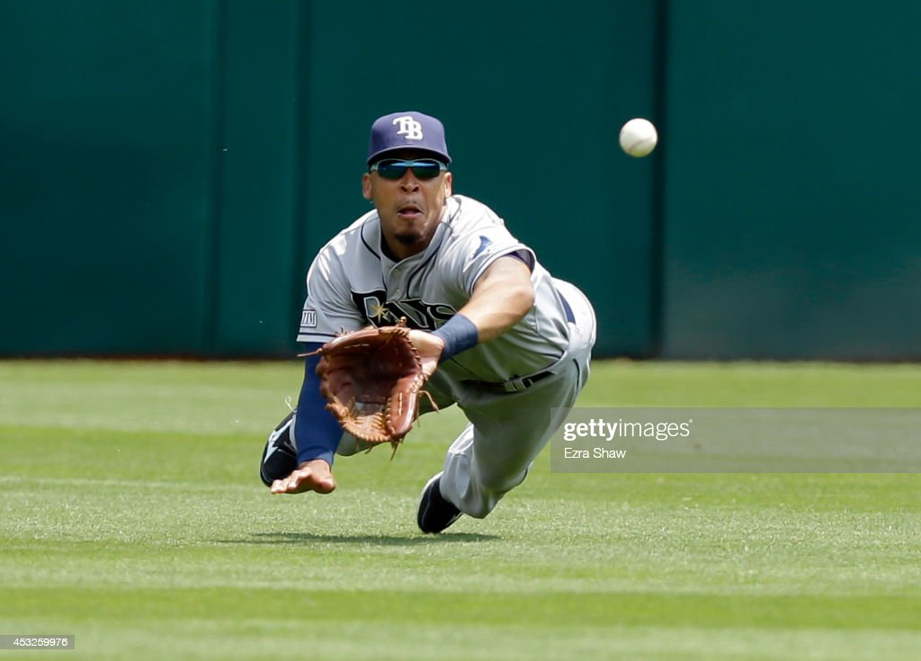 Desmond Jennings of the Tampa Bay Rays dives to catch a ball hit by John Jaso of the Oakland Athletics in the first inning at Oco Coliseum on August...