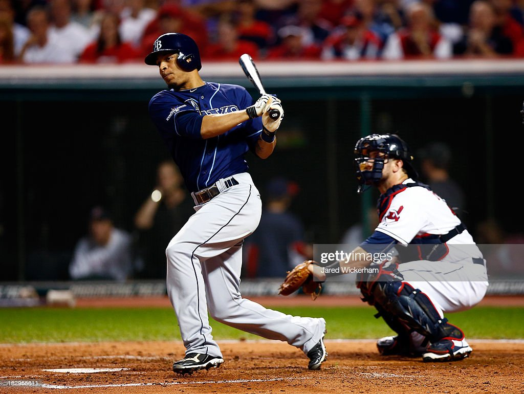 <a gi-track='captionPersonalityLinkClicked' href=/galleries/search?phrase=Desmond+Jennings&family=editorial&specificpeople=5974085 ng-click='$event.stopPropagation()'>Desmond Jennings</a> #8 of the Tampa Bay Rays hits an hits RBI double to left field against Danny Salazar #31 of the Cleveland Indians in the fourth inning during the American League Wild Card game at Progressive Field on October 2, 2013 in Cleveland, Ohio.