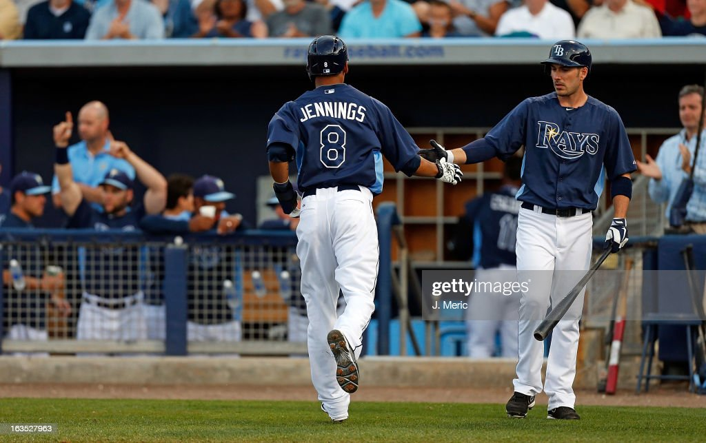 <a gi-track='captionPersonalityLinkClicked' href=/galleries/search?phrase=Desmond+Jennings&family=editorial&specificpeople=5974085 ng-click='$event.stopPropagation()'>Desmond Jennings</a> #8 of the Tampa Bay Rays is congratulated by Matt Joyce #20 after scoring against the Minnesota Twins during a Grapefruit League spring training game at the Charlotte Sports Complex on March 11, 2013 in Port Charlotte, Florida.