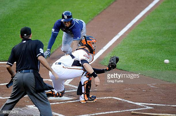 Desmond Jennings of the Tampa Bay Rays is tagged out at home plate in the first inning by Caleb Joseph of the Baltimore Orioles at Oriole Park at...