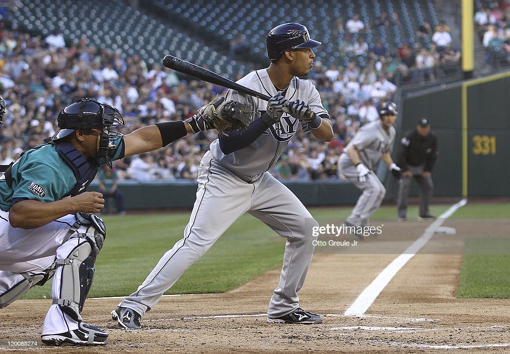<a gi-track='captionPersonalityLinkClicked' href=/galleries/search?phrase=Desmond+Jennings&family=editorial&specificpeople=5974085 ng-click='$event.stopPropagation()'>Desmond Jennings</a> #8 of the Tampa Bay Rays takes ball four to force in teammate <a gi-track='captionPersonalityLinkClicked' href=/galleries/search?phrase=Casey+Kotchman&family=editorial&specificpeople=240573 ng-click='$event.stopPropagation()'>Casey Kotchman</a> #11 from third base in the second inning against the Seattle Mariners at Safeco Field on July 29, 2011 in Seattle, Washington.