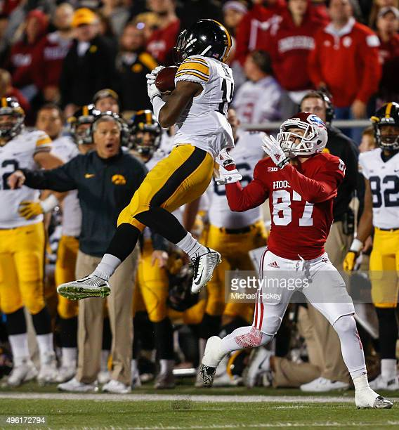 Desmond King of the Iowa Hawkeyes goes up for an interception in front of Mitchell Paige of the Indiana Hoosiers at Memorial Stadium on November 7...