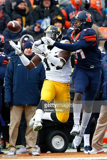 Desmond King of the Iowa Hawkeyes intercepts the ball in front of Justin Hardee of the Illinois Fighting Illini at Memorial Stadium on November 19...